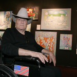 Tony Curtis Sits Front His Work During Presentation