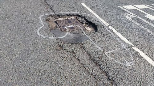 Anonymous Artist Wanksy Draws Penises Potholes Make Government Fix Them Bored